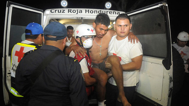 PHOTO: An injured inmate is carried as he arrives at the hospital after a fire broke out at the prison in Comayagua, Honduras, a town 90 miles north of the Central American countrys capital, Tegucigalpa, Feb. 15, 2012.