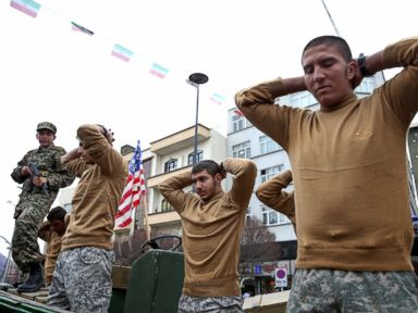 PHOTO: Members of Iranian Basij paramilitary force re-enact the January capture of U.S sailors by the Revolutionary Guard in the Persian Gulf, in a rally commemorating the 37th anniversary of Islamic Revolution in Tehran, Iran, Feb. 11, 2016.
