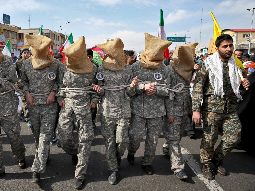 PHOTO: Members of Iranian Basij paramilitary force reenact the January capture of U.S sailors by the Revolutionary Guard in the Persian Gulf, in a rally commemorating the 37th anniversary of Islamic Revolution in Tehran, Iran, Feb. 11, 2016.