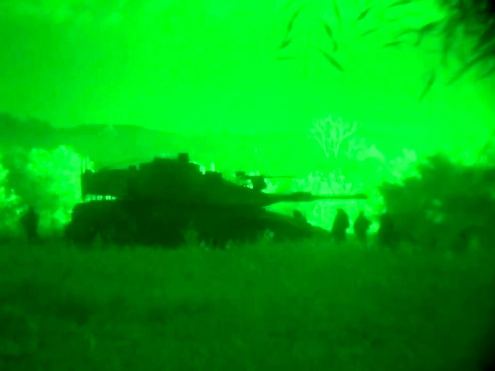 PHOTO: This image made from video shot through a night vision scope released by the Israeli military, July 18, 2014, shows a tank in the Gaza Strip during a ground offensive.