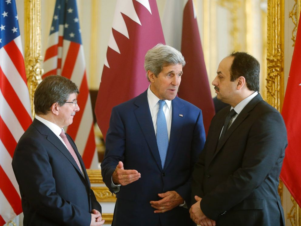 PHOTO: U.S. Secretary of State John Kerry, center, speaks with Qatari Foreign Minister Khaled al-Attiyah, right, and Turkish Foreign Minister Ahmet Davutoglu on July 26, 2014 in Paris.