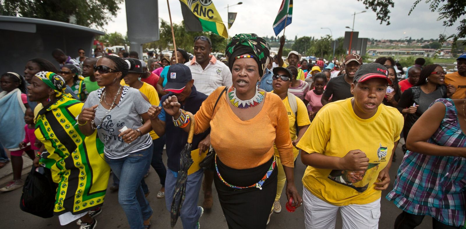 PHOTO: Township residents march to celebrate the life of Nelson Mandela