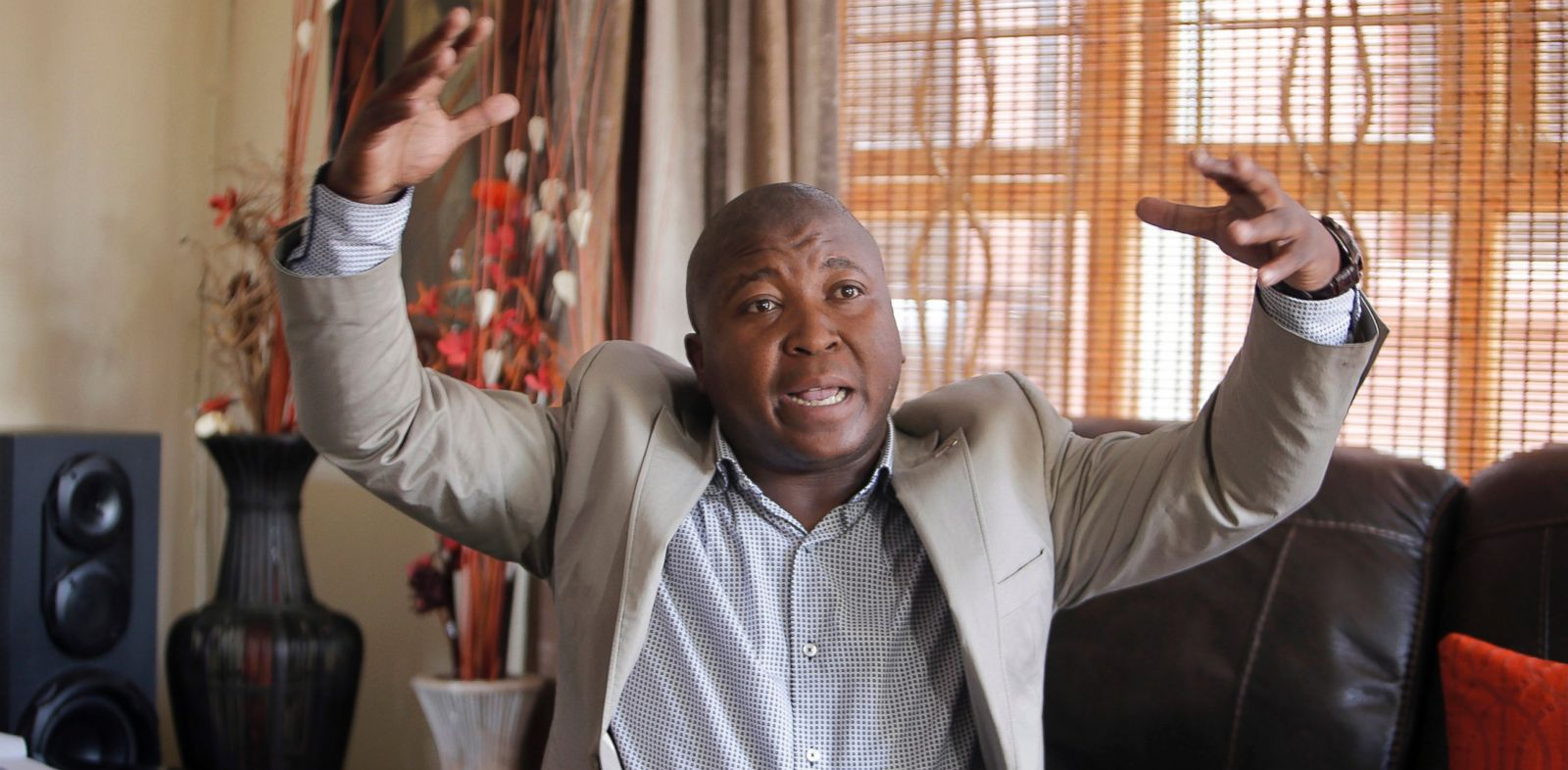 PHOTO: Thamsanqa Jantjie gesticulates at his home during an interview with the Associated Press in Johannesburg, Dec. 12, 2013.