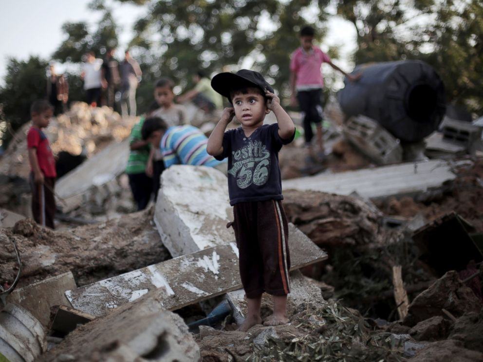 PHOTO: A Palestinian boy stands in the rubble of a destroyed house the day after an Israeli strike in the town of Beit Hanoun, Gaza Strip, July 9, 2014.