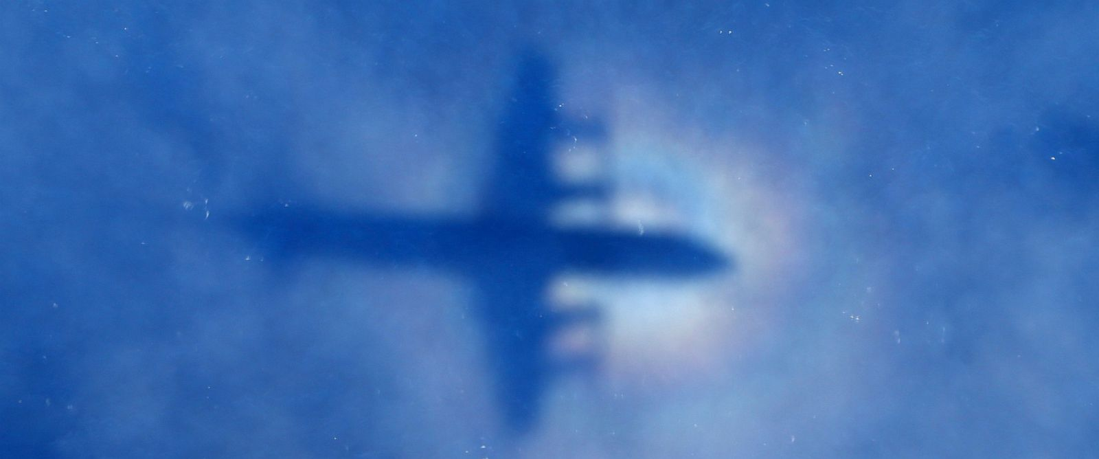 PHOTO:In this March 31, 2014 file photo, a shadow of a Royal New Zealand Air Force P-3 Orion aircraft is seen on low cloud cover while it searches for missing Malaysia Airlines Flight MH370 in the southern Indian Ocean.