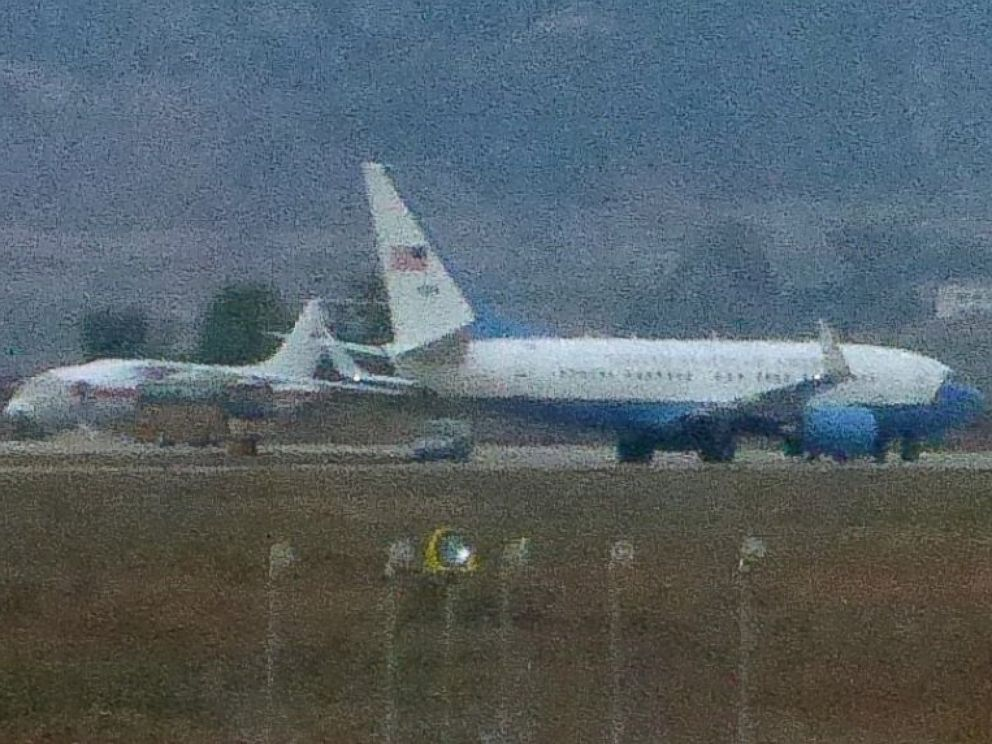 PHOTO: A United States Air Force passenger jet, right, is parked in Pyongyang, North Korea