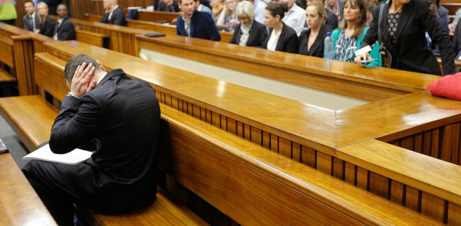 PHOTO: Oscar Pistorius blocks his ears inside the high court on the second day of his trial in Pretoria, South Africa, March 4, 2014. Pistorius is charged with murder for the shooting death of his girlfriend, Reeva Steenkamp, on Valentines Day in 2013.