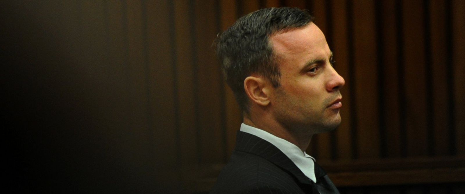 PHOTO: Oscar Pistorius, listens as he sits in the dock waiting for proceedings to begin in court in Pretoria, South Africa, March 18, 2014.