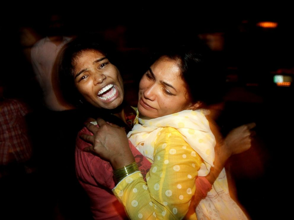 PHOTO: Women comfort each other as they mourn over the death of a family member who was killed in a bomb blast, at a local hospital in Lahore, Pakistan, March, 27, 2016.