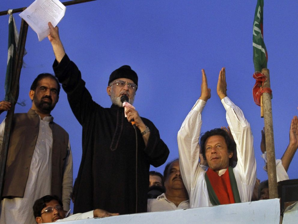 PHOTO: Pakistans fiery cleric Tahir-ul-Qadri, second left, delivers his speech during a protest in Islamabad, Pakistan, Sept. 2, 2014.