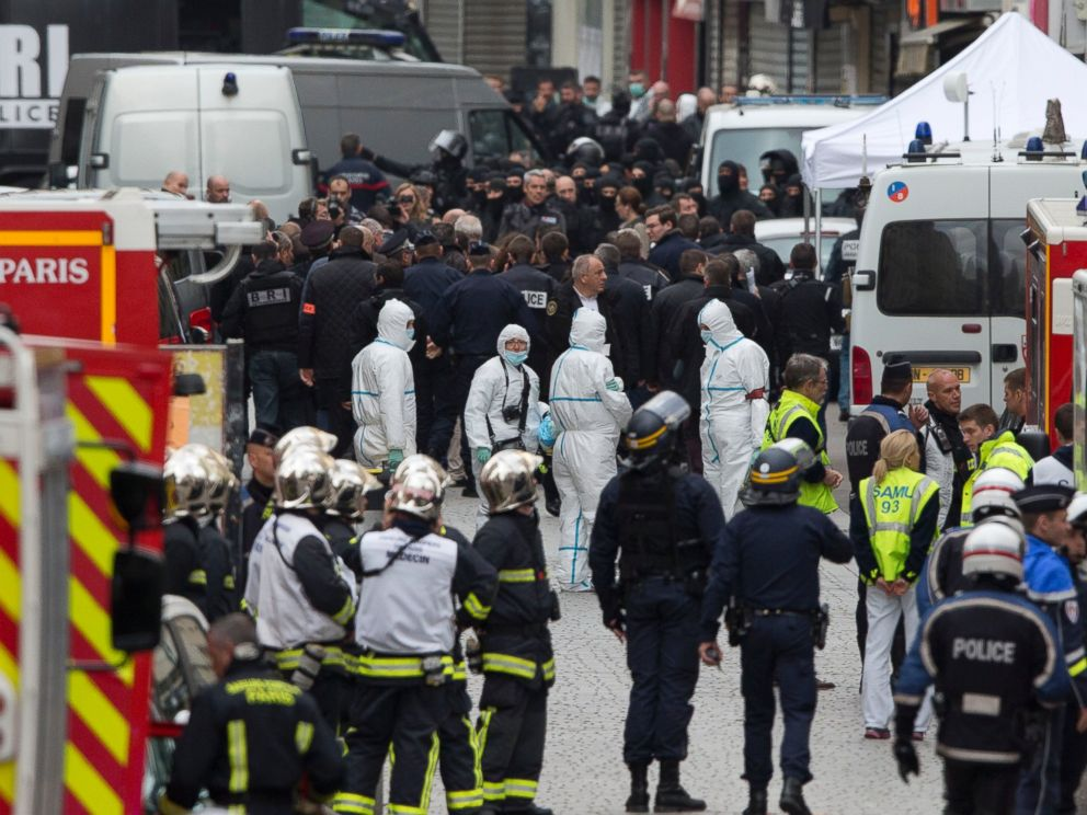 PHOTO: Forensic experts in white suits wait for a go ahead after an operation of security forces against a group of extremists in Saint Denis, near Paris, Nov. 18, 2015.