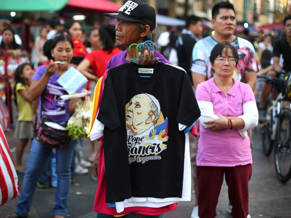 PHOTO: A man sells shirts printed with an image of Pope Francis in downtown Manila, Philippines, Jan. 4, 2015.
