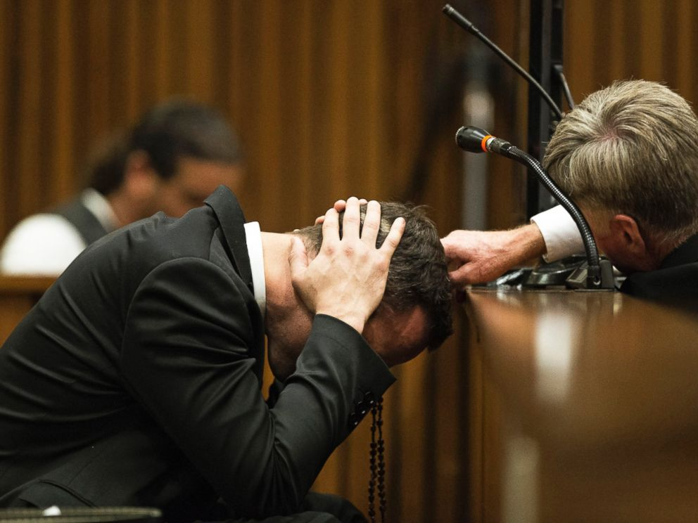 PHOTO: Oscar Pistorius, listens to evidence from a witness speaking about the morning of the shooting of his girlfriend Reeva Steenkamp, in court on the fourth day of his trial at the high court in Pretoria, South Africa, March 6, 2014.