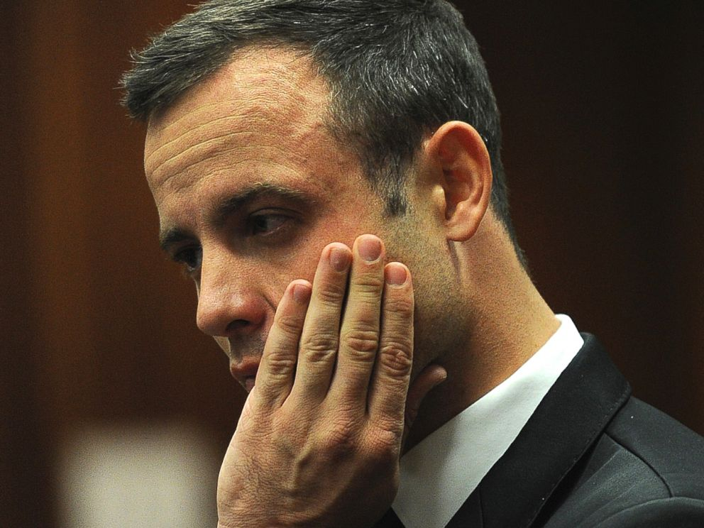 PHOTO: Oscar Pistorius puts his hand to his face in court on the fourth day of his trial at the high court in Pretoria, South Africa, March 6, 2014.
