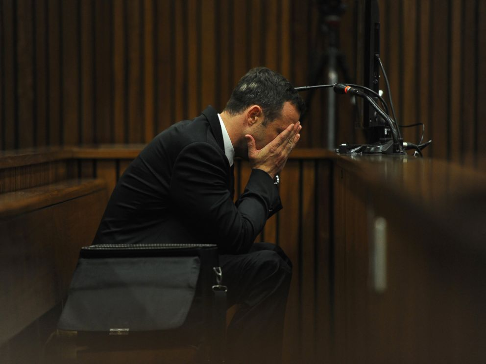 PHOTO: Oscar Pistorius listens to evidence from a witness speaking about the morning of the shooting of his girlfriend Reeva Steenkamp on the fourth day of his trial at the high court in Pretoria, South Africa, March 6, 2014.