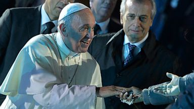 PHOTO: Pope Francis greets people during a vigil on Copacabana beach in Rio de Janeiro, Brazil, Saturday, July 27, 2013.