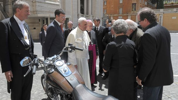 PHOTO: In this June 12, 2013 photo provided by the Vatican paper LOsservatore Romano, Pope Francis stands by a Harley-Davidson he was donated, at the Vatican.
