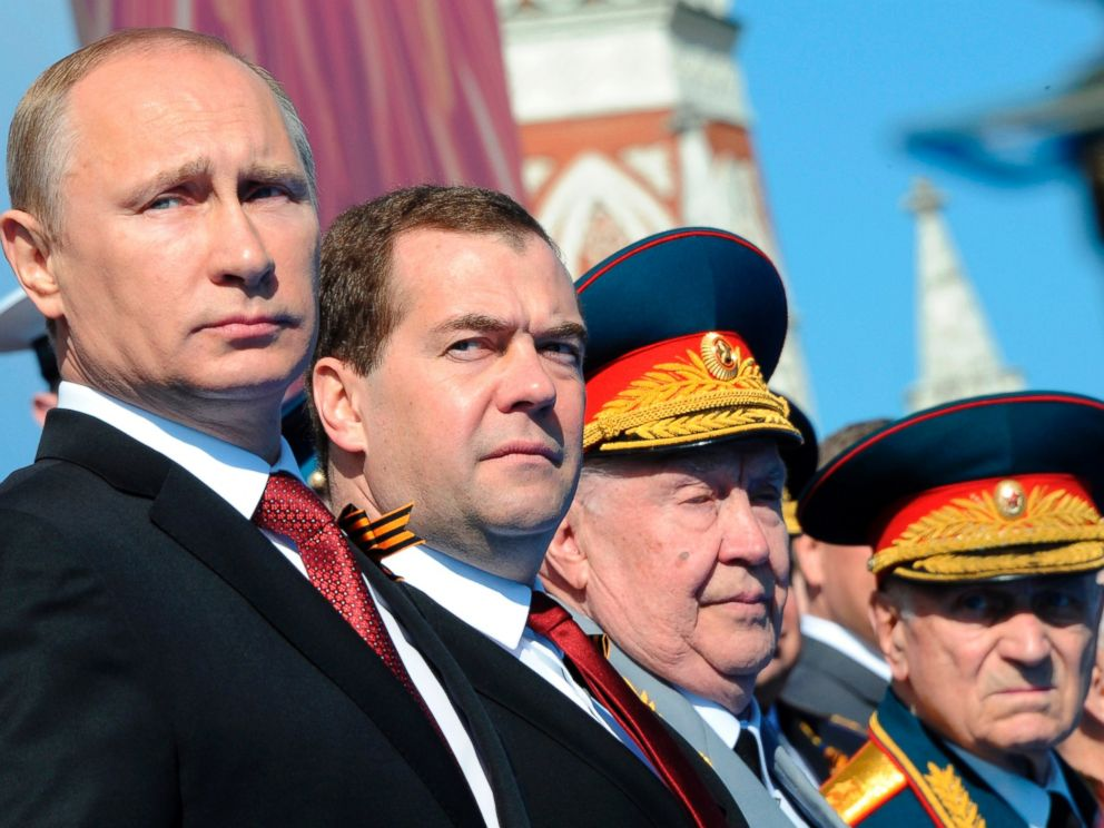 PHOTO: Russian President Vladimir Putin, left, attends a Victory Day parade, which commemorates the 1945 defeat of Nazi Germany, at Red Square in Moscow, Russia on May 9, 2014.