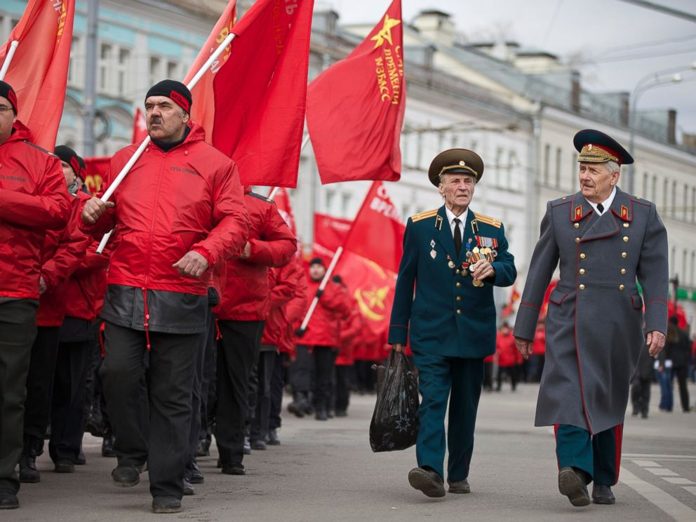 PHOTO: Demonstrators wearing red and two WWII veterans, right, march in support of Kremlin-backed plans for the Ukrainian province of Crimea to break away and merge with Russia, in Moscow, Saturday, March 15, 2014.