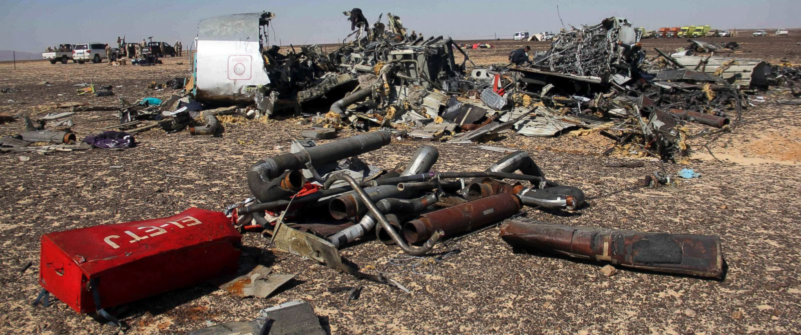 PHOTO: Egyptian security forces stand guard by debris of a Russian airplane at the site a day after the passenger jet bound for St. Petersburg, Russia crashed in Hassana, Egypt, Nov. 1, 2015.
