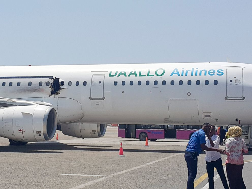 PHOTO:A hole is seen in a plane operated by Daallo Airlines as it sits on the runway of the airport in Mogadishu, Somalia, Feb. 2, 2016.