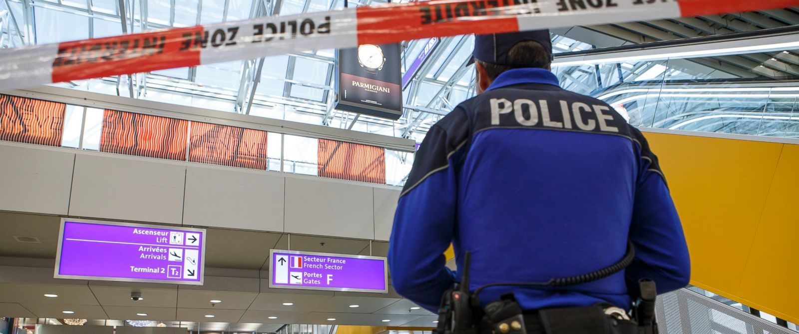 PHOTO: A Swiss police officer observes an area at the Geneva airport after finding an abandoned luggage during a high level of alert, in Geneva, Switzerland, Dec. 11, 2015.