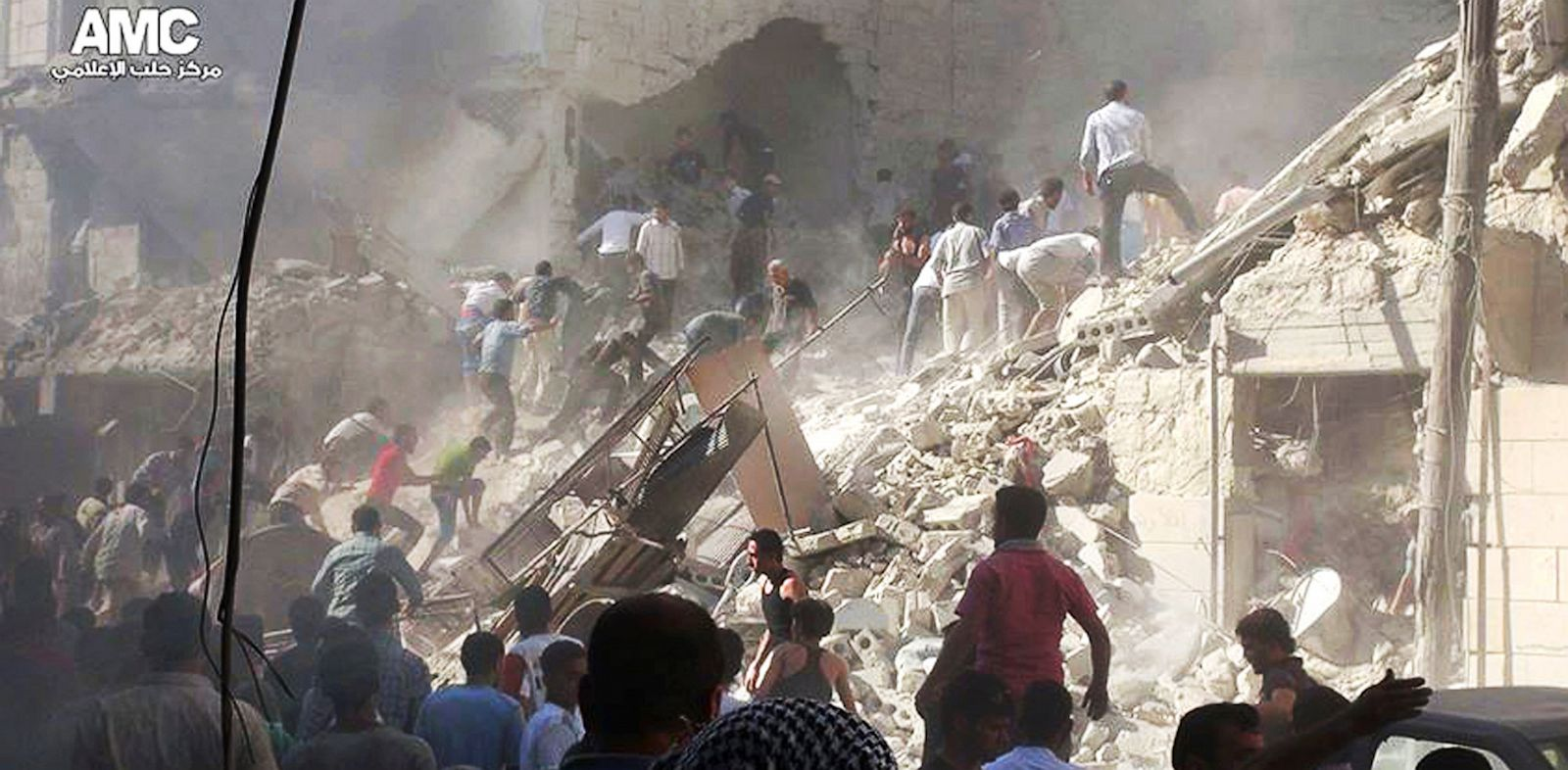 PHOTO: Syrians inspect the rubble of damaged buildings due to heavy shelling by Syrian government forces in Aleppo, Syria, Aug. 26, 2013, in this citizen journalism image, which has been authenticated based on its contents and other AP reporting,