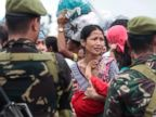 PHOTO: A woman breaks into tears as she waits for their turn to ride a military plane to flee their typhoon-ravaged homes in Tacloban city, Leyte province, central Philippines, Nov. 12, 2013.