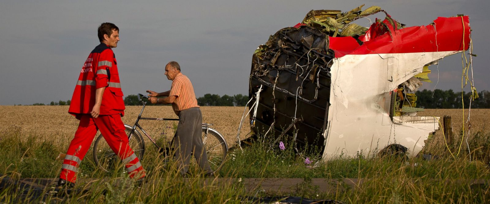 PHOTO: A paramedic walks by a part of fuselage at the crash site of Malaysia Airlines Flight 17 near the village of Hrabove, eastern Ukraine, July 19, 2014.