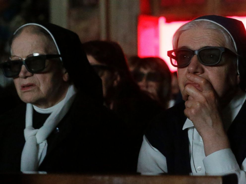 PHOTO: Nuns wear 3D glasses to watch the screening of the canonization of Pope John XXIII and Pope John Paul II taking place at the Vatican, at the parish church in Sotto il Monte Giovanni XXIII,Sunday, April 27, 2014.