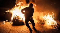 PHOTO: A protester runs from a barricade after other protesters set it on fire during minor clashes with Turkish security forces, Oct. 12, 2015, in Instanbul.