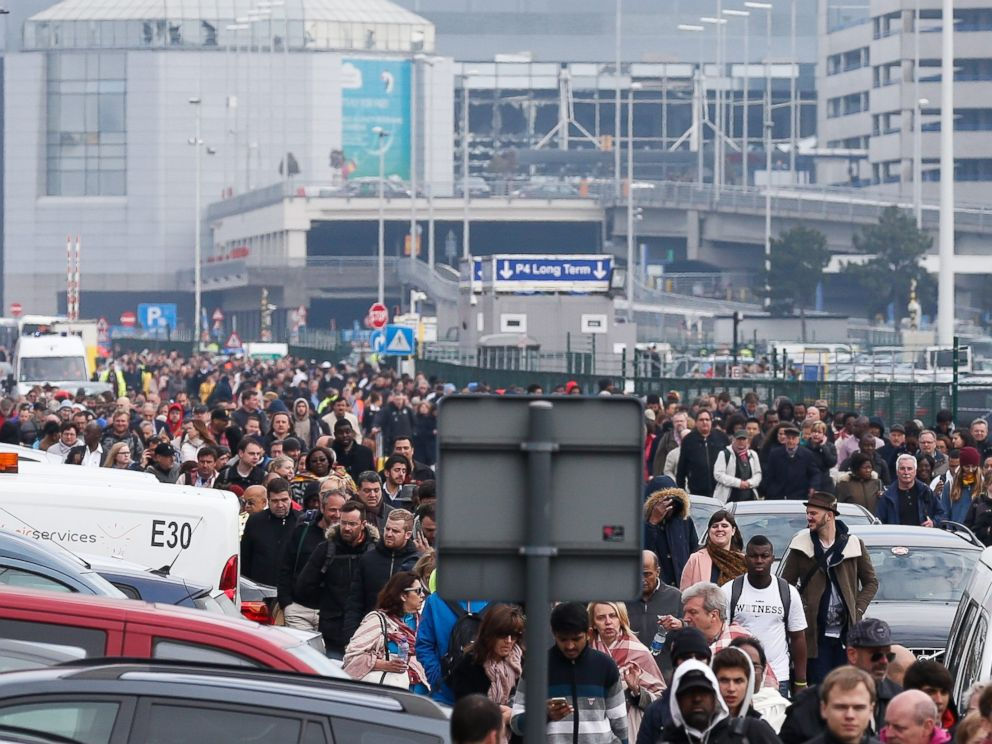 PHOTO: Passengers and airport staff are evacuated from the terminal building after explosions at Brussels Airport in Brussels, March 22, 2016.