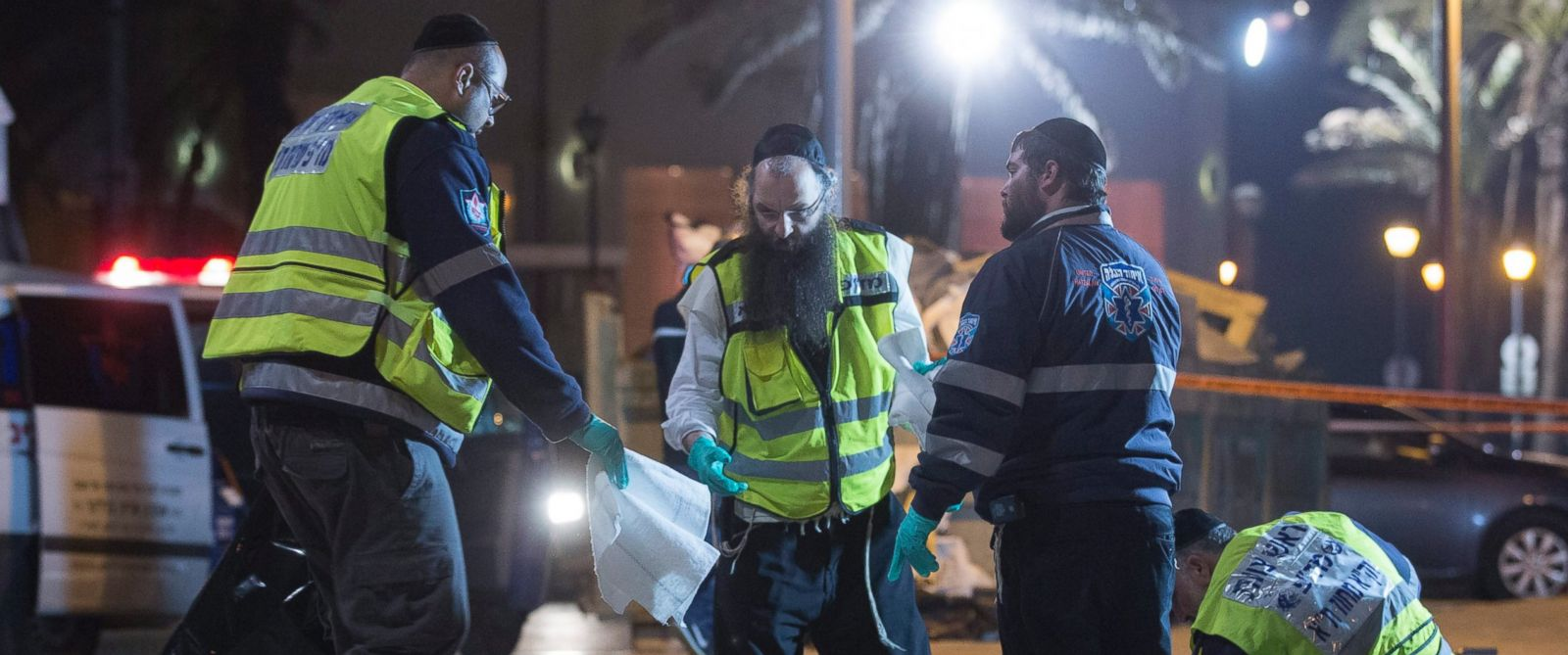 PHOTO: An ultra-Orthodox Jewish burial society cleaning up blood and medical bandages at the scene of a stabbing attack in old Jaffa, just south of Tel Aviv, Israel, March 8, 2016.