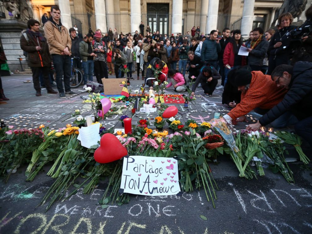 PHOTO: People gather to leave tributes at the Place de la Bourse following todays attacks, March 22, 2016 in Brussels.