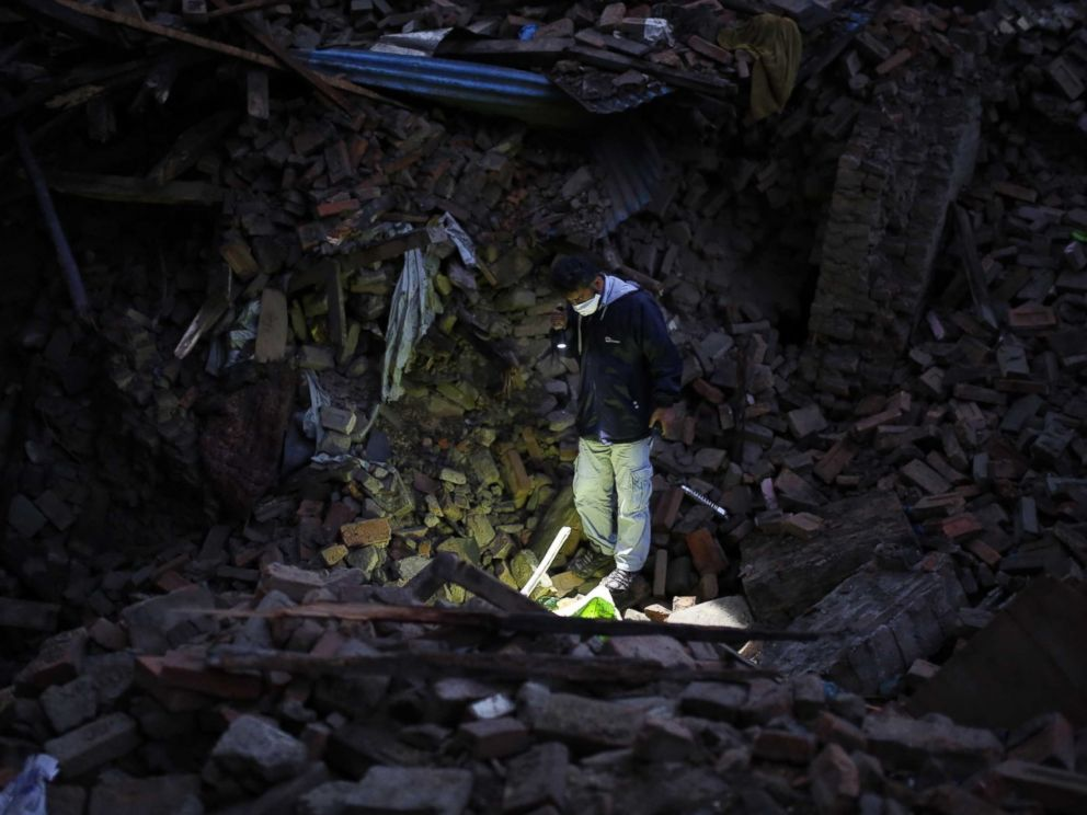 PHOTO: A member of IHH Humanitarian Relief Foundation attends a rescue operation among the debris of a house after a powerful earthquake hits Bhaktapur, Nepal on April 27, 2015.