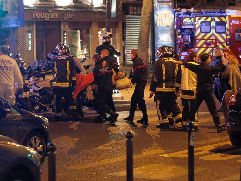 PHOTO: Medics move a wounded man near the Boulevard des Filles-du-Calvaire after an attack November 13, 2013 in Paris, France. Gunfire and explosions in multiple locations erupted in the French capital with early casualty reports indicating many dead.