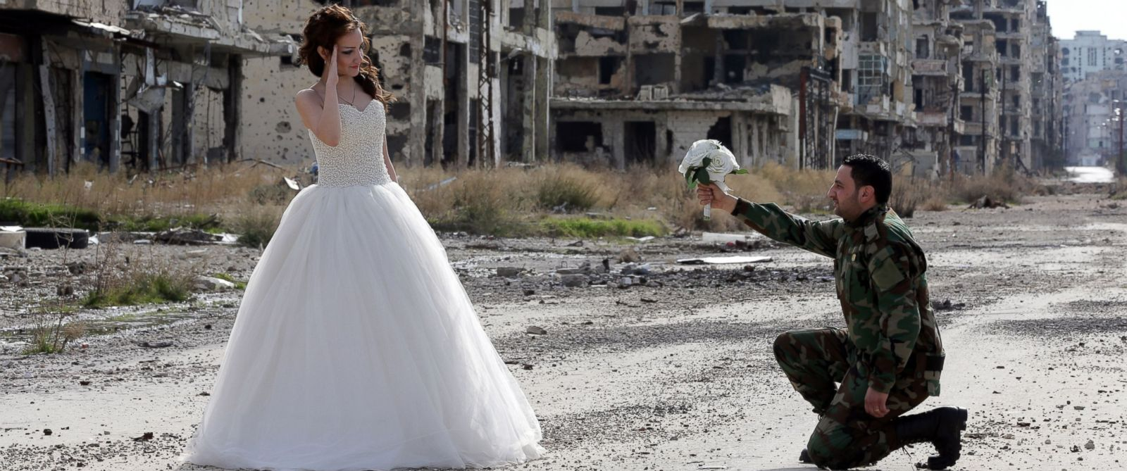 PHOTO: Newly-wed Syrian couple Nada Merhi,and Syrian army soldier Hassan Youssef, pose for a wedding picture amid heavily damaged buildings in the war ravaged city of Homs on Feb. 5, 2016.