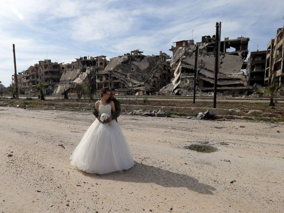 PHOTO: Newly-wed Syrian couple Nada Merhi, and Syrian army soldier Hassan Youssef, pose for a wedding picture amid heavily damaged buildings in the war ravaged city of Homs on Feb. 5, 2016
