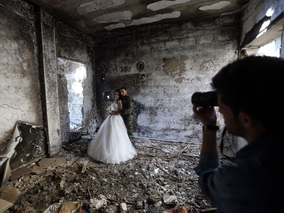 PHOTO: Newly-wed Syrian couple Nada Merhi, and Hassan Youssef, have their wedding pictures taken in a heavily damaged building in the war ravaged city of Homs on Feb. 5, 2016.