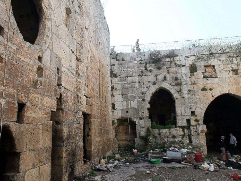 PHOTO:Syrian government forces inspect items left by rebel fighters in the famed Crusader castle, Krak de Chevaliers in the Homs region, March 21, 2014, after they recaptured the castle the previous day.