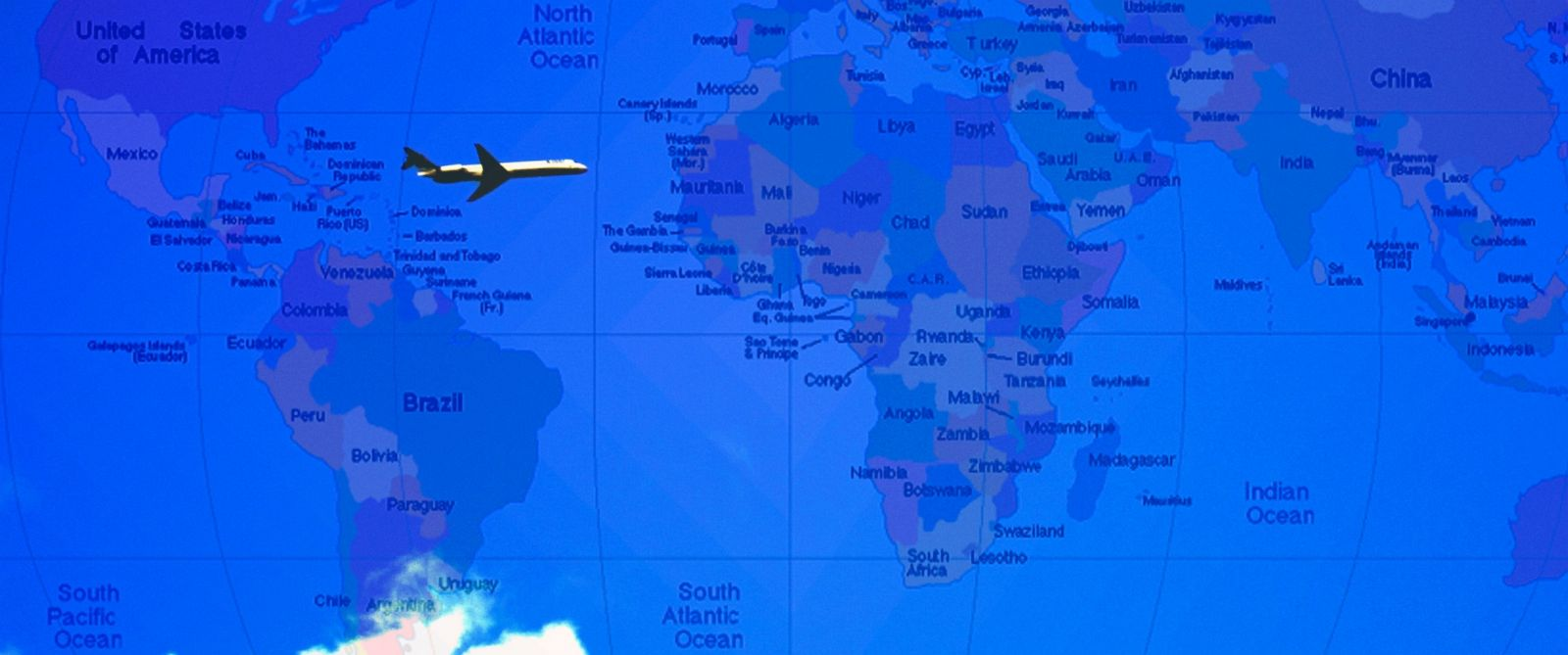 PHOTO: An airplane is shown flying over a map of the world.