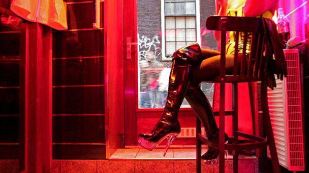 PHOTO: A German prostitute, called Eve, waits for clients behind her window in the red light district of Amsterdam, Dec. 8, 2008.