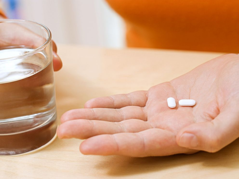 PHOTO: A woman with aspirin is pictured in this stock image.
