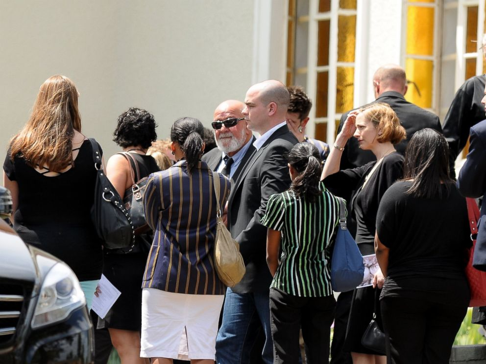 PHOTO: Barry Steenkamp, Reevas father, is surrounded by family and friends
