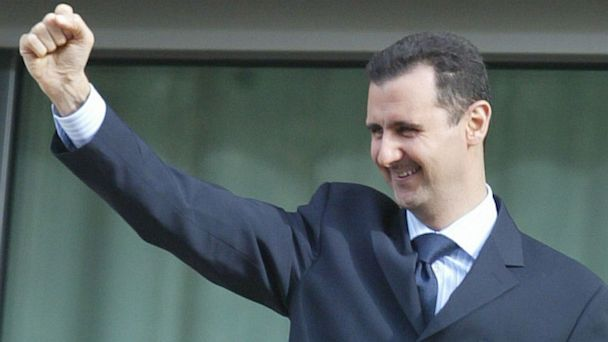 PHOTO: Bashar al-Assad salutes the crowd during a demonstration in Damascus, March 2005.