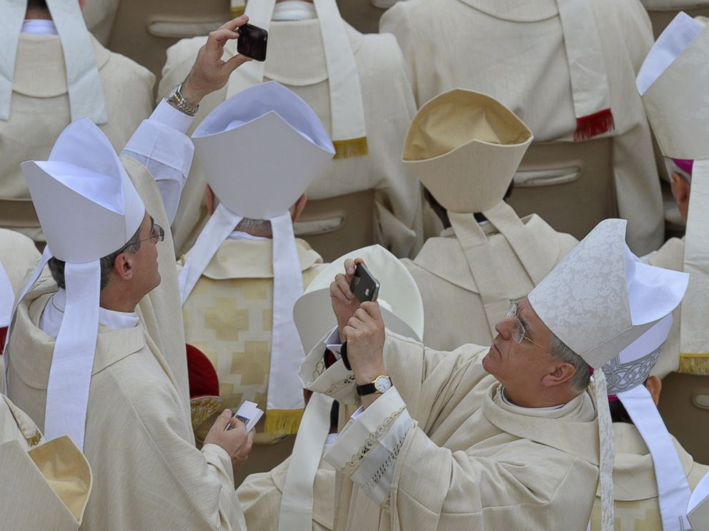 PHOTO: Bishops take pictures before the canonization mass of Popes John XXIII and John Paul II on St Peters at the Vatican on April 27, 2014.