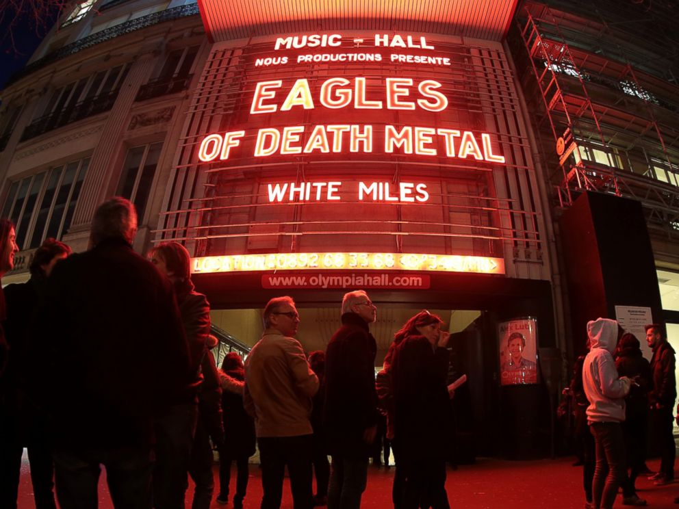 PHOTO: People standing outside the Olympia concert venue in Paris, a few hours ahead of a concert by Eagles of Death Metal, Feb. 16, 2016.
