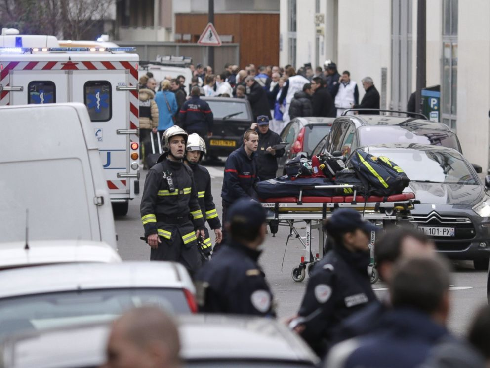 PHOTO: Firefighters push a stretcher outside the headquarters of the French satirical newspaper Charlie Hebdo in Paris on Jan. 7, 2015.