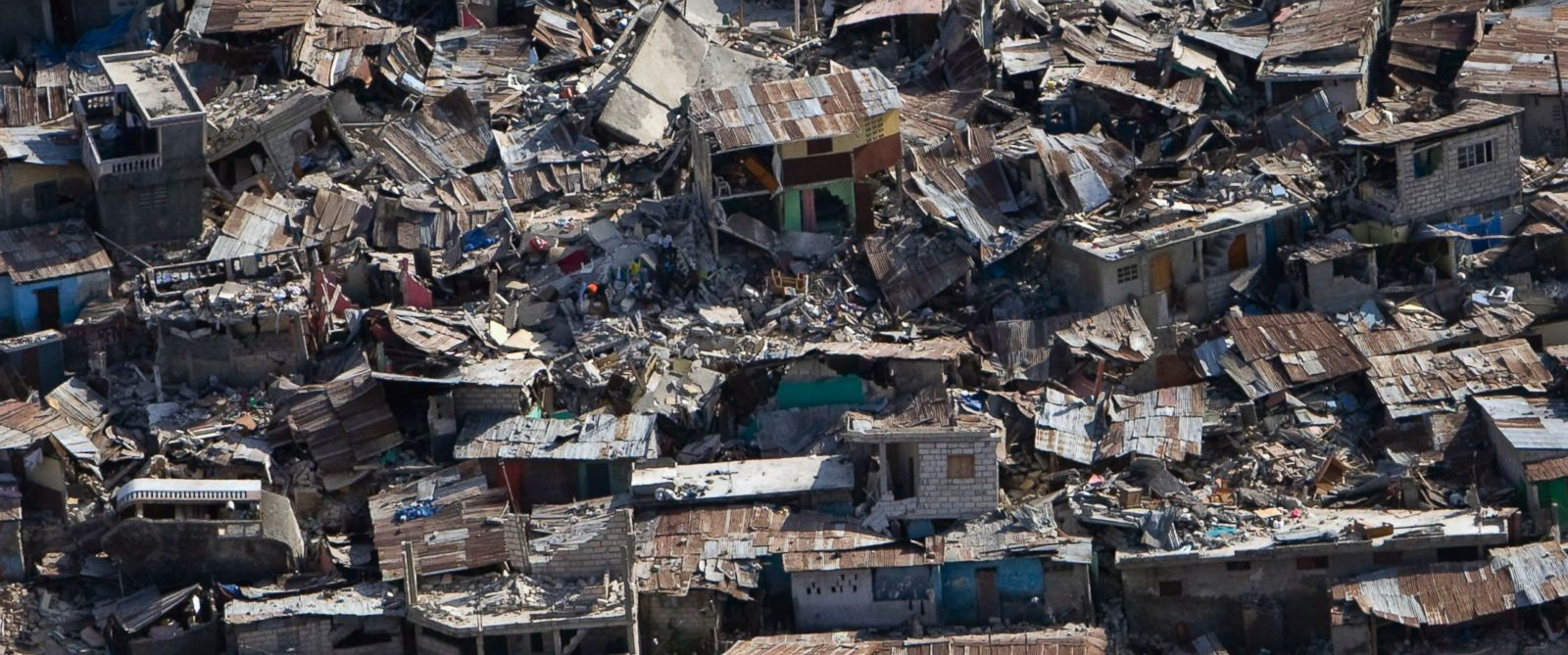 PHOTO: Houses in a poor neighborhood sit destroyed after an earthquake in this Jan. 13, 2010 file photo in Port-au-Prince, Haiti.