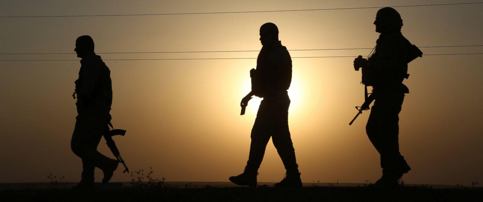 PHOTO: Kurdish peshmergas patrol the town of Rabia